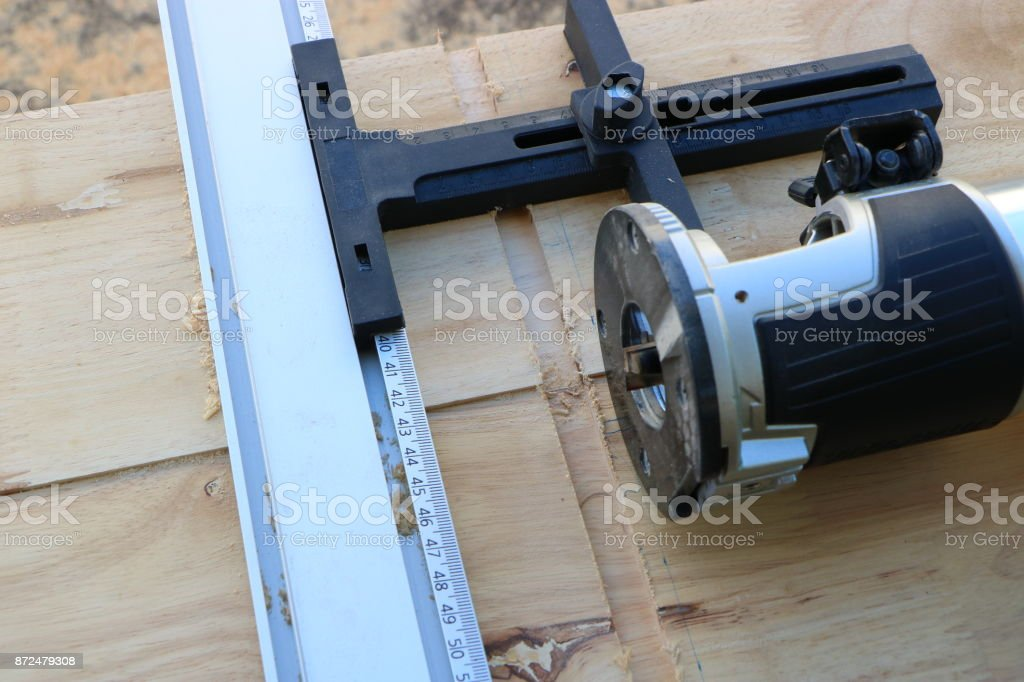 Dado cutting; Making a groove on wood stock photo