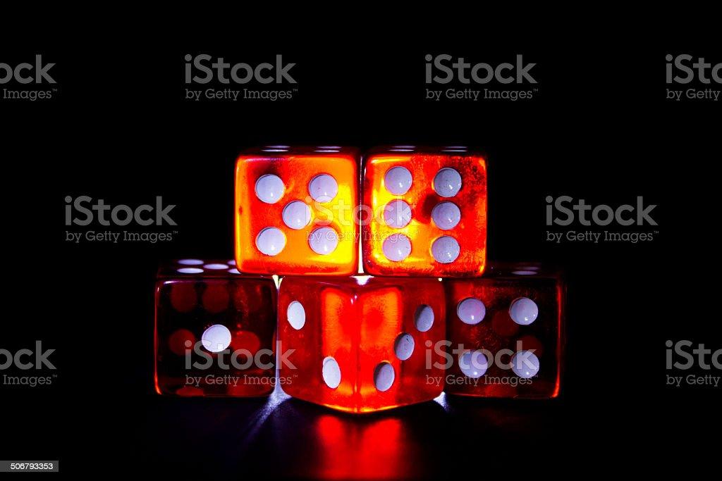 dados rojos a contra luz con fondo negro stock photo