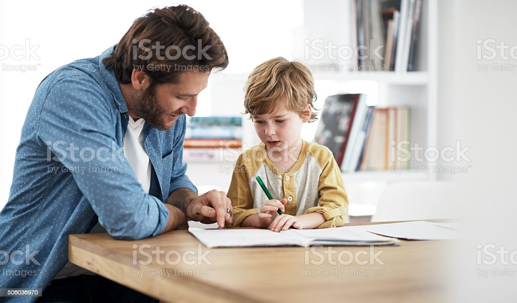 Dad's really good at explaining stuff stock photo