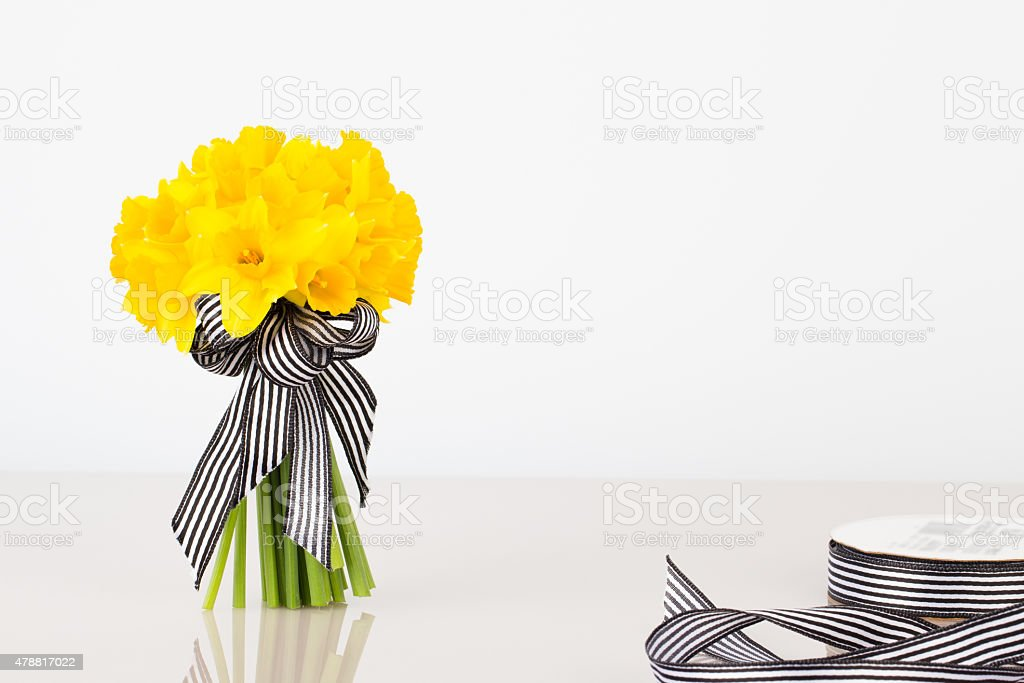 Daffodil bouquet with ribbon stock photo