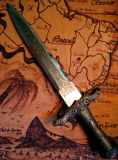 dagger and map - swashbuckler stock photos and pictures