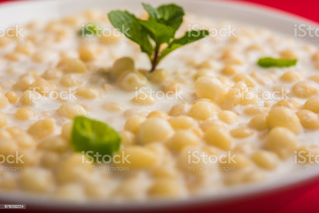 Dahi Bundi or Boondi Raita, favourite indian started or side dish made using Rajasthani snack food made from sweetened, fried chickpea flour, called Boondi with sweet and salty curd or buttermilk stock photo