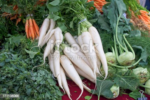 Daikon radish, kohlrabi carrots and rapini at the farmer's market