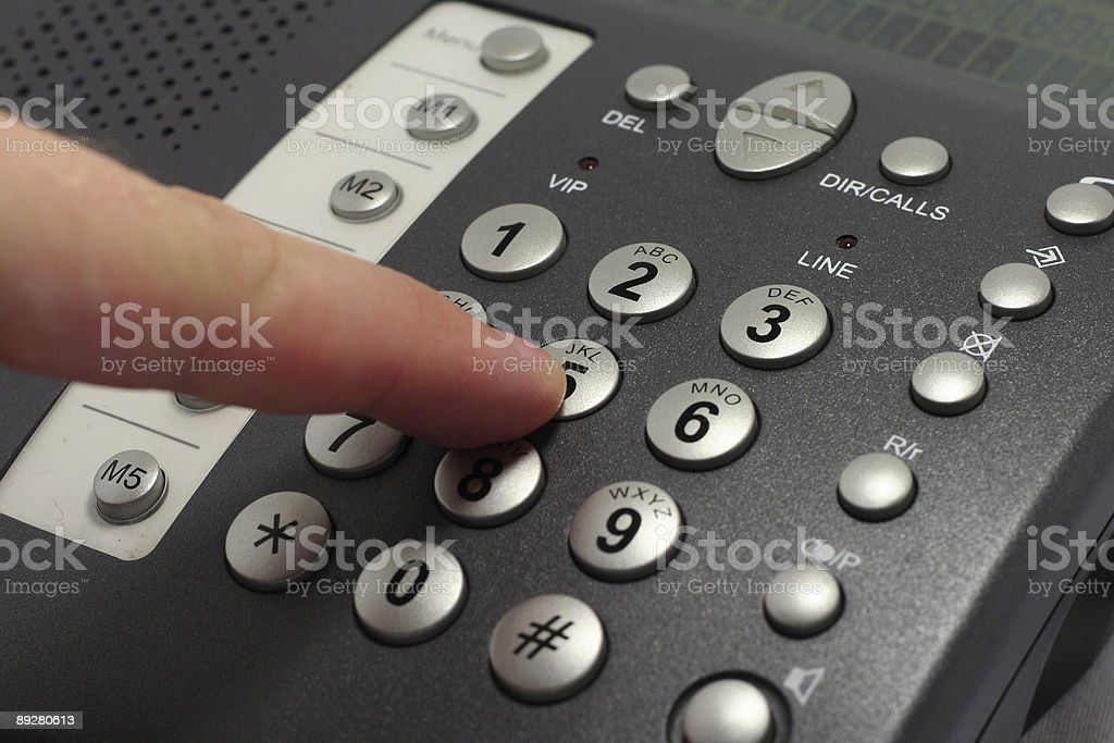 Dailing number 5 on a black telephone stock photo