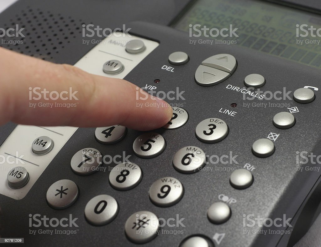 Dailing number on a telephone royalty-free stock photo