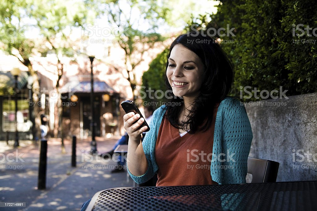 dailing on a cell phone royalty-free stock photo