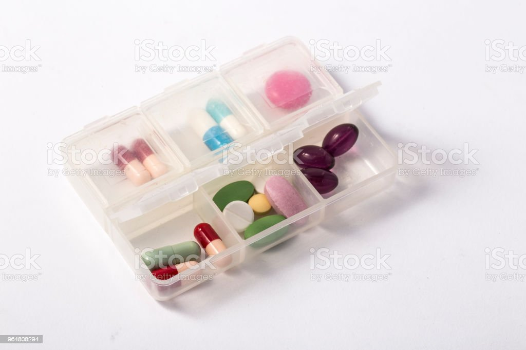 Daily drug dose / pills organized in a pill case royalty-free stock photo