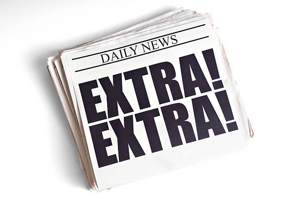 Daily Extra! Newspaper Headline on White Background stock photo