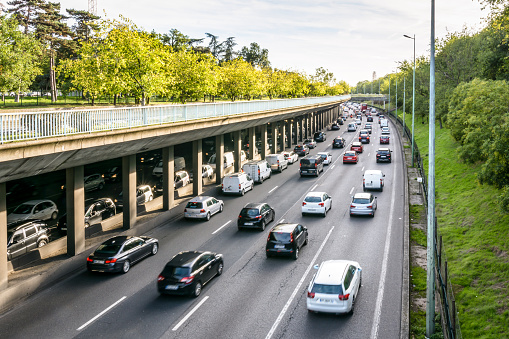 Daily heavy traffic on the ring road of Paris at the evening rush hour.