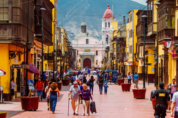 Daily image of passers-by strolling through the streets of Rimac, in the metropolitan area of Lima, Peru stock photo
