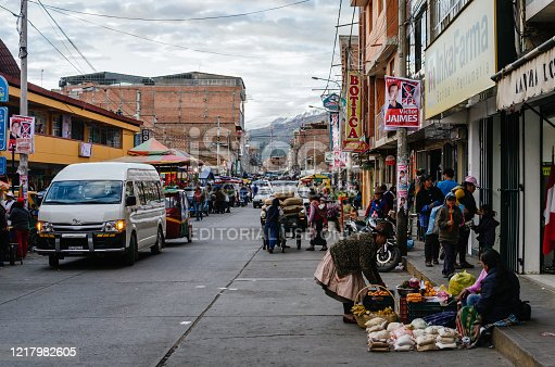 Huaraz, Peru, July 28, 2014: daily life hustle in andean city street with food vendors and vehicles, in election period