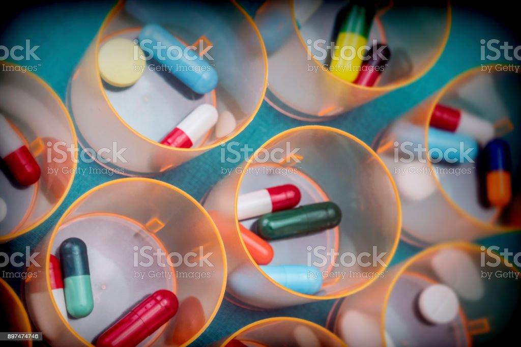 Daily medication at a hospital table, conceptual image stock photo