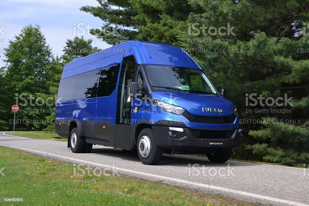 IVECO Daily minibus driving on the street stock photo