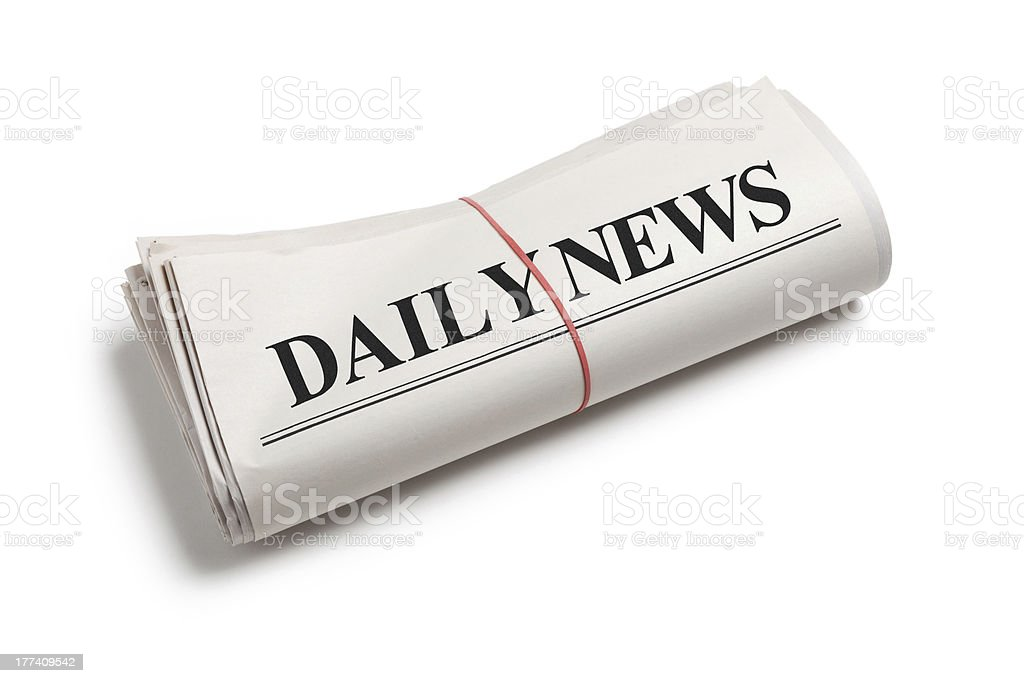 Daily News newspaper folded up on white background stock photo