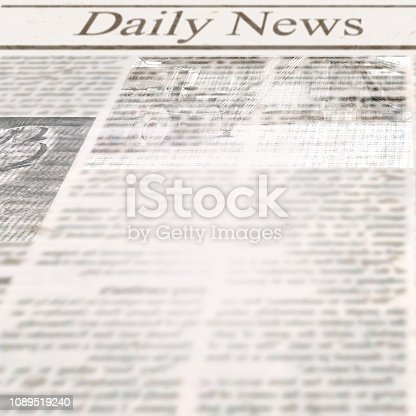 istock Daily news newspaper with headline and old unreadable text 1089519240