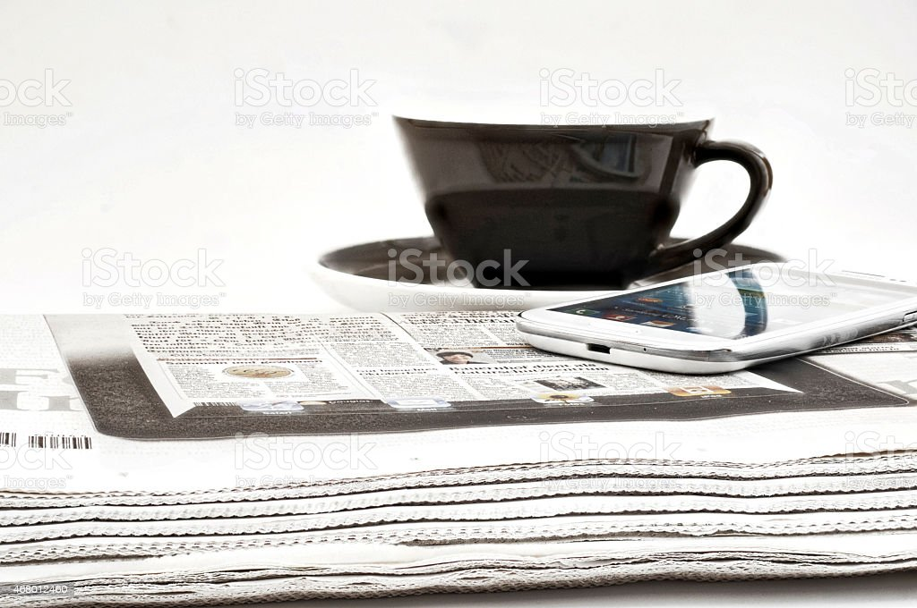 Daily newspaper, a cup of coffee, Smartphone stock photo