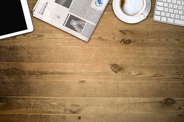 Daily newspaper and tablet pc on the wooden table. Daily newspaper and tablet pc on the wooden table. Text generated Lorem ipsum. article stock pictures, royalty-free photos & images
