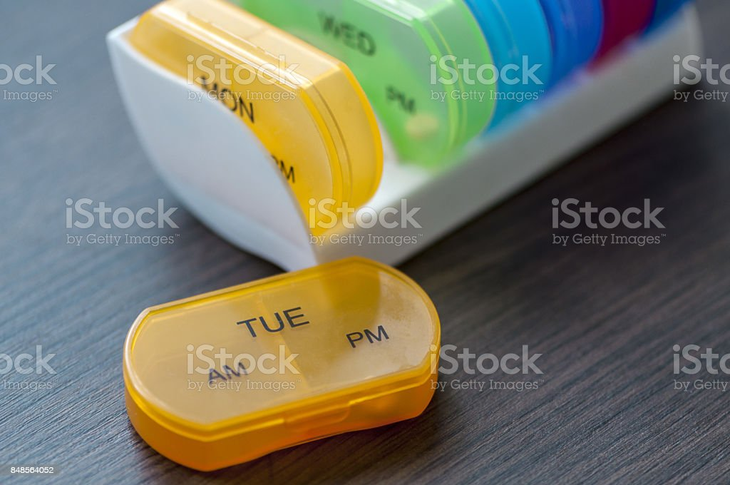 Daily pill boxes stock photo