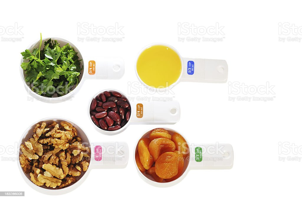 daily ration of fruit and vegetables in cup measures royalty-free stock photo