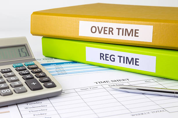 Daily time record with blank payroll time sheet stock photo