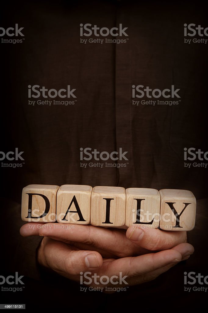 Daily - Toy Blocks in Hands on Dark Background royalty-free stock photo