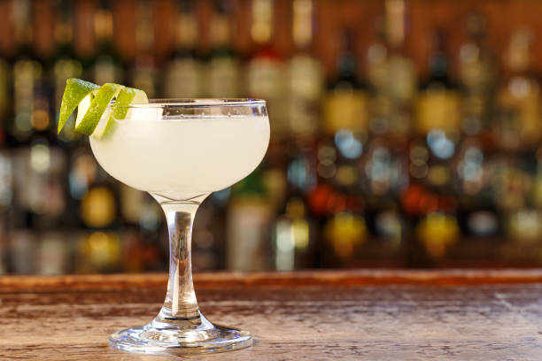 Daiquiri cocktail Daiquiri cocktail with rum and lime juice. Traditional taste. The cocktail is on the bar in a pub or restaurant. Space for text. margarita stock pictures, royalty-free photos & images