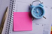 istock dairy calendar with mini alarm clock 1257024152