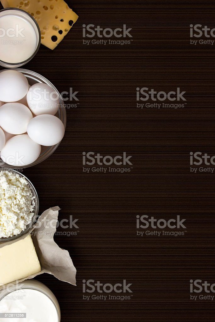 Dairy products and eggs. Background image. Space for text stock photo