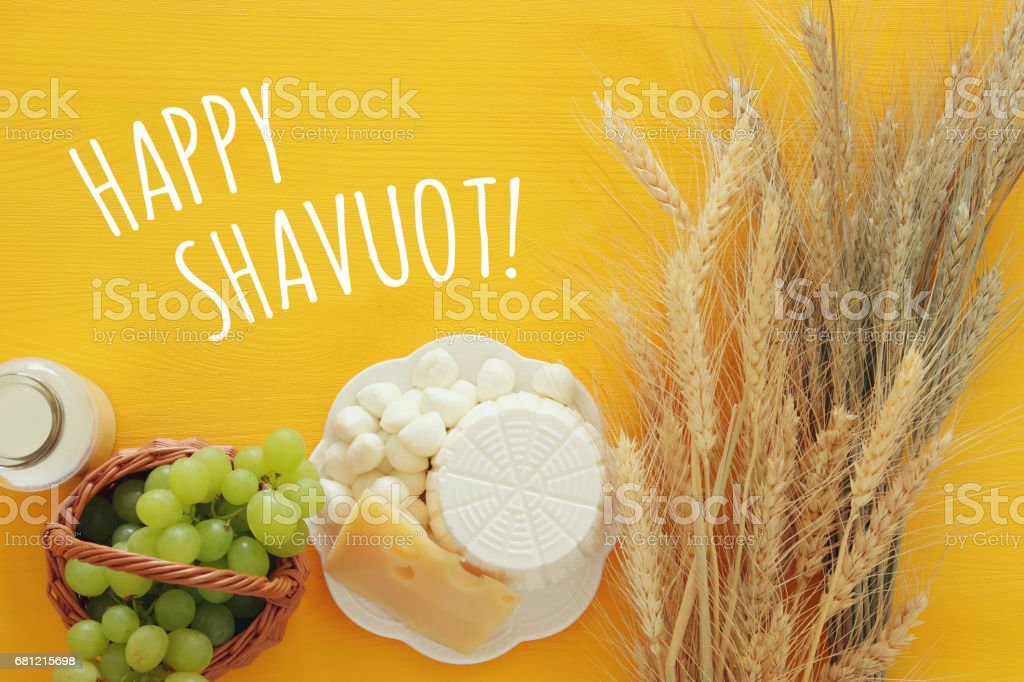 dairy products and fruits. Symbols of jewish holiday - Shavuot royalty-free stock photo