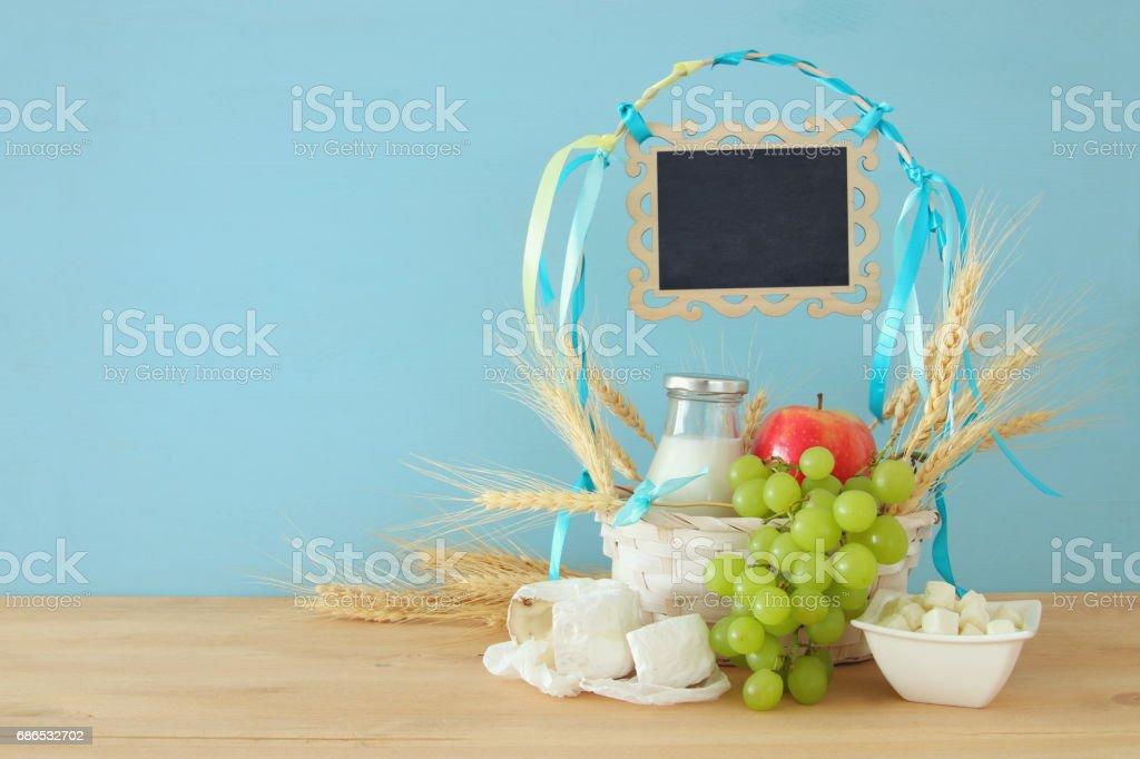 dairy products and fruits. Symbols of jewish holiday - Shavuot zbiór zdjęć royalty-free