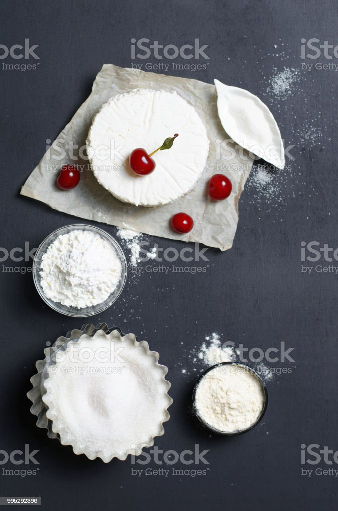 Dairy Products Flour Sugar And Cherries On Black Background