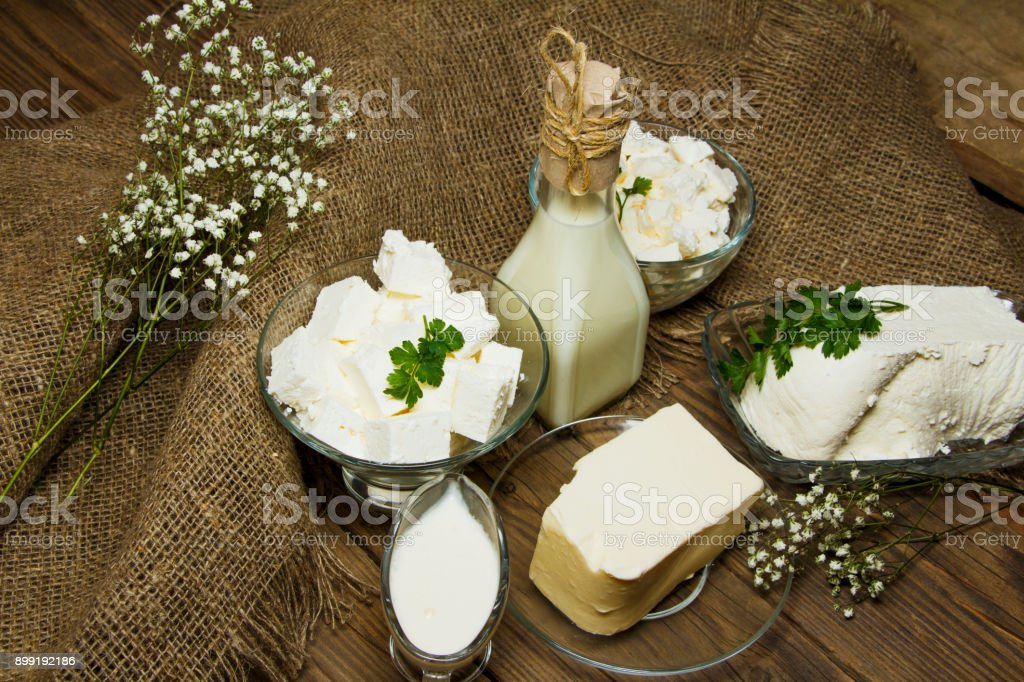 Dairy products on a wooden background and burlap, top view