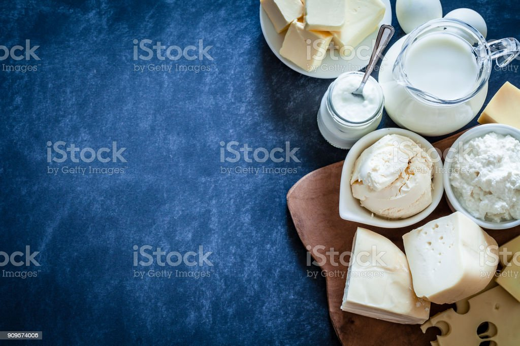 Dairy products shot on bluish tint background stock photo