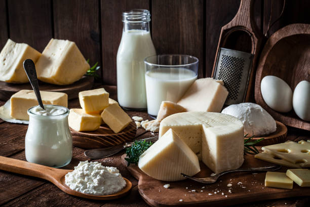 dairy products shot on rustic wooden table - formaggio foto e immagini stock