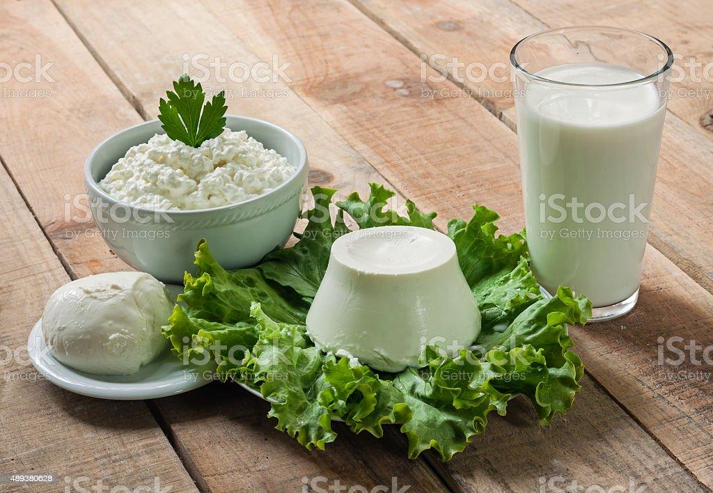 Dairy products. Sour cream, milk, cheese, mozzarella, ricotta stock photo
