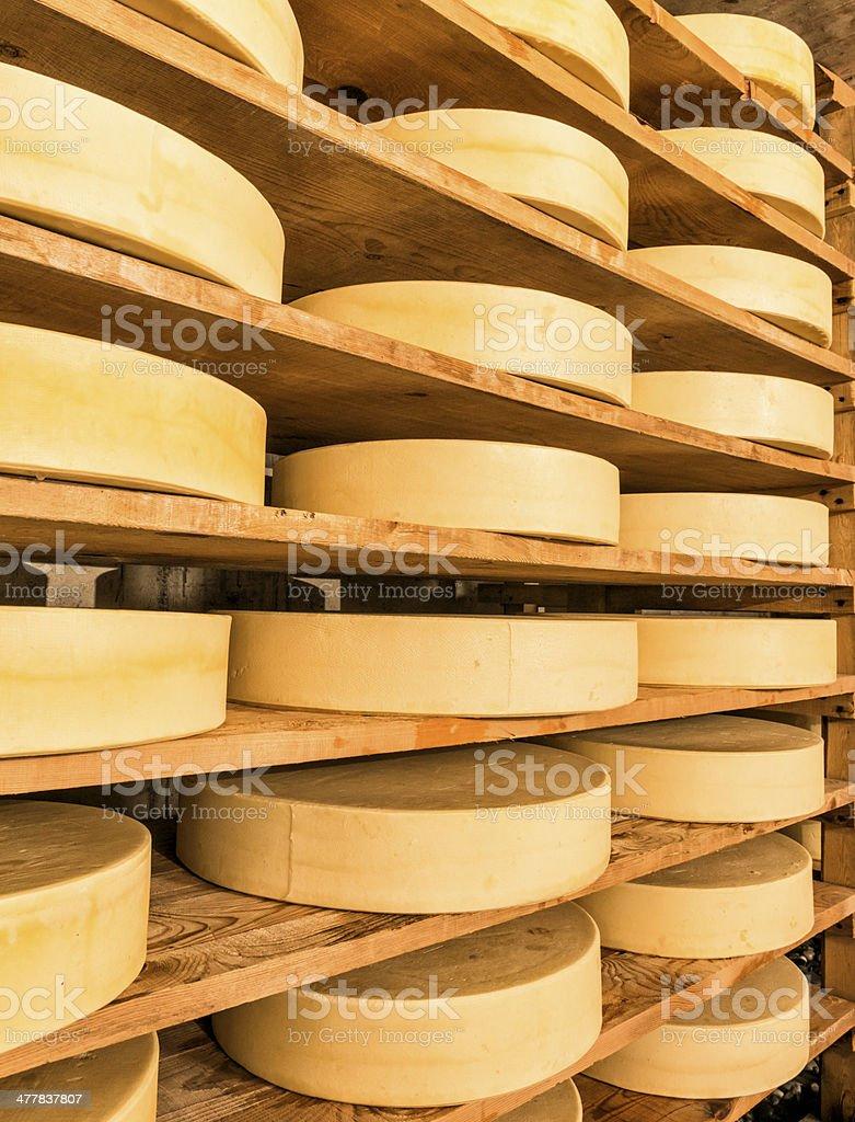 dairyman producing cheese on alpine dairy stock photo