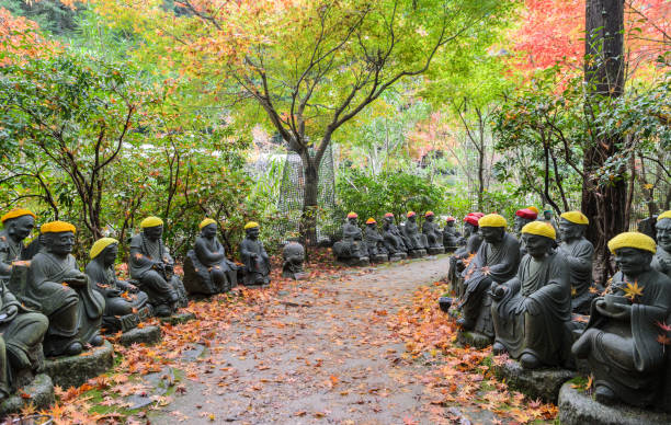 Daisho-in Temple grounds in Hiroshima, Japan Miyajima, Japan - November 20, 2016: Autumn Japanese garden with Buddha sculpture lined up pathways at Daisho-in Temple grounds in Miyajima Island,  Hiroshima, Japan miyajima stock pictures, royalty-free photos & images