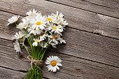 Daisy chamomile flowers on wood