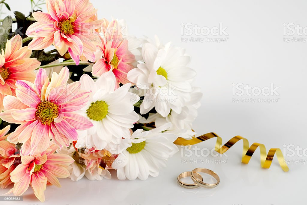 Daisy with gold ribbon royalty-free stock photo