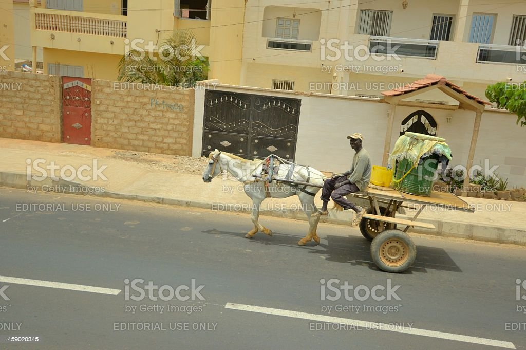 Dakar Delivery Man And Horse Drawn Cart royalty-free stock photo