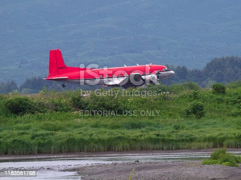 A vintage DC3 Dakota aircraft lands on Kodiak Island, Alaska