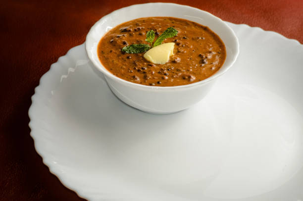 Dal Bukhara Dal Bukhara is a rich, creamy slow cooked whole urad dal (black gram) with tomato puree, butter and cream. This recipe is made famous by ITC Maurya Hotel in Delhi. muziekfestival stock pictures, royalty-free photos & images