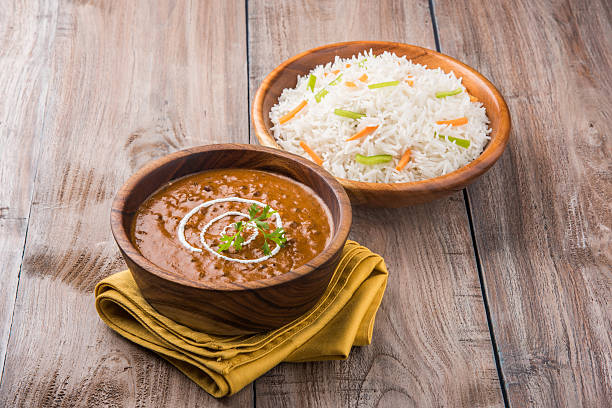 dal makhani / daal makhani/dal makhni with plain basmati rice dal makhani or daal makhani or dal makhni with plain basmati rice, served in wooden bowl dal makhani stock pictures, royalty-free photos & images