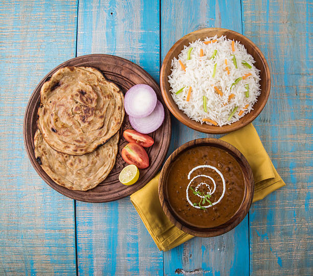 Dal Makhani or Daal Makhani, indian lunch/dinner menu Dal Makhani or daal makhni or Daal makhani, indian lunch/dinner item served with plain rice and butter Roti, Chapati, Paratha and salad dal makhani stock pictures, royalty-free photos & images
