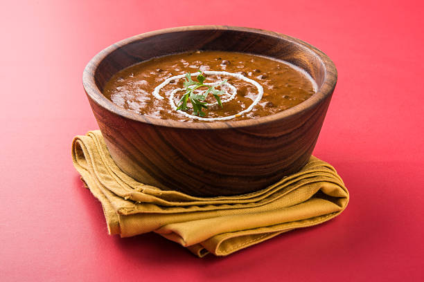 dal makhani or dal makhani or daal makhni dal makhani or dal makhani or daal makhni or kali dal with fresh cream and Coriander topping, served in a bowl, isolated dal makhani stock pictures, royalty-free photos & images