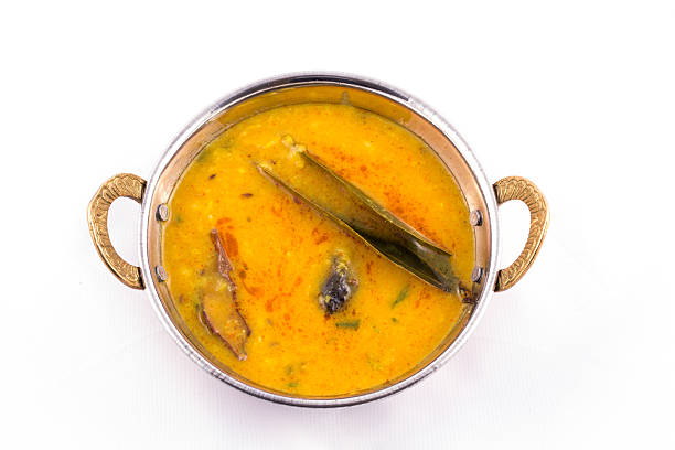 Dal tadka - north indian food - yellow dal fry Dal tadka - north indian food with raw spices for extreme flavor - yellow dal fry dal makhani stock pictures, royalty-free photos & images