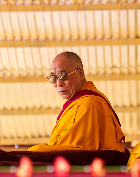 Dalai Lama is friendly looking at the listeners stock photo