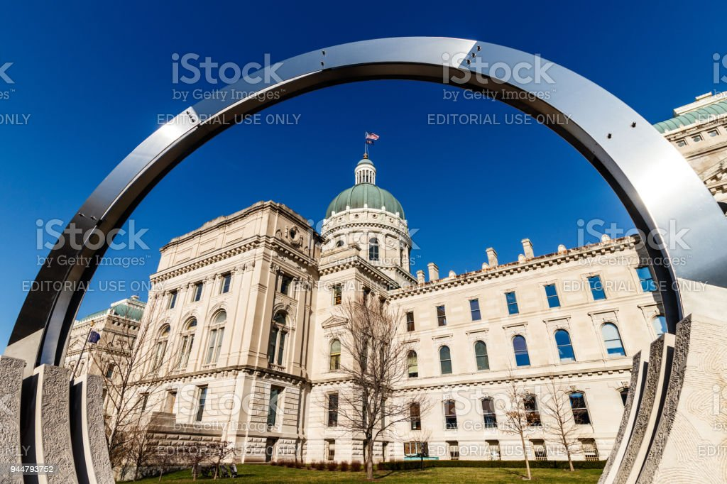 Dale Enochs' 'Time Flow' framing the Indiana State House. Part of the Indiana State House Public Art Collection I stock photo
