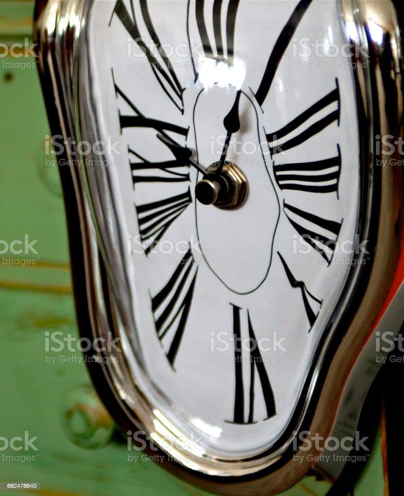 Dali style clock with roman numerals stock photo