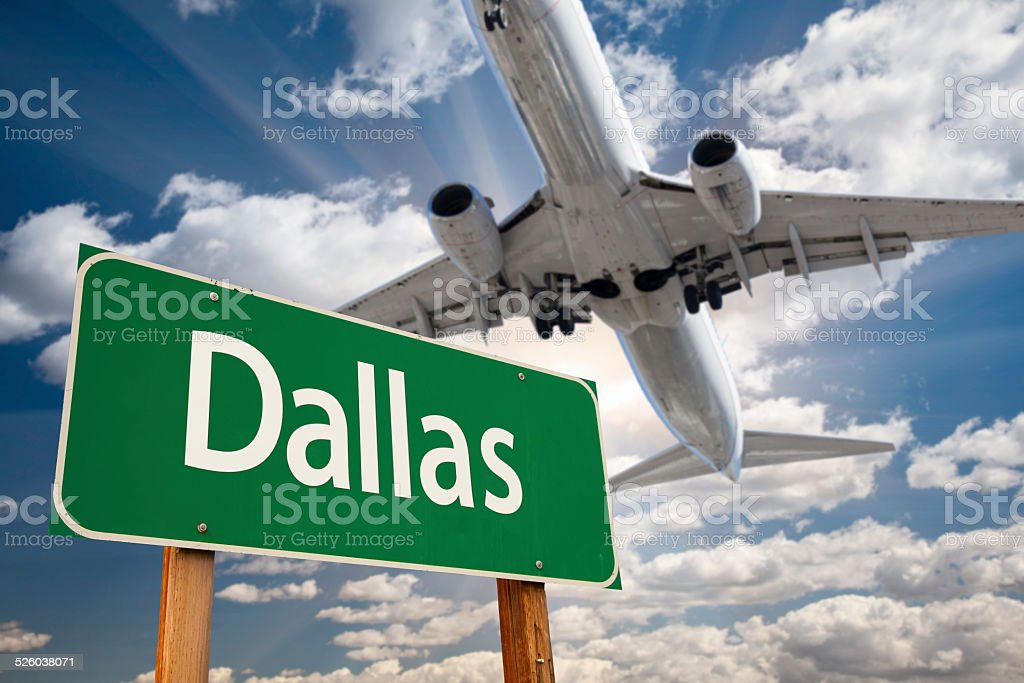 Dallas Green Road Sign and Airplane Above royalty-free stock photo